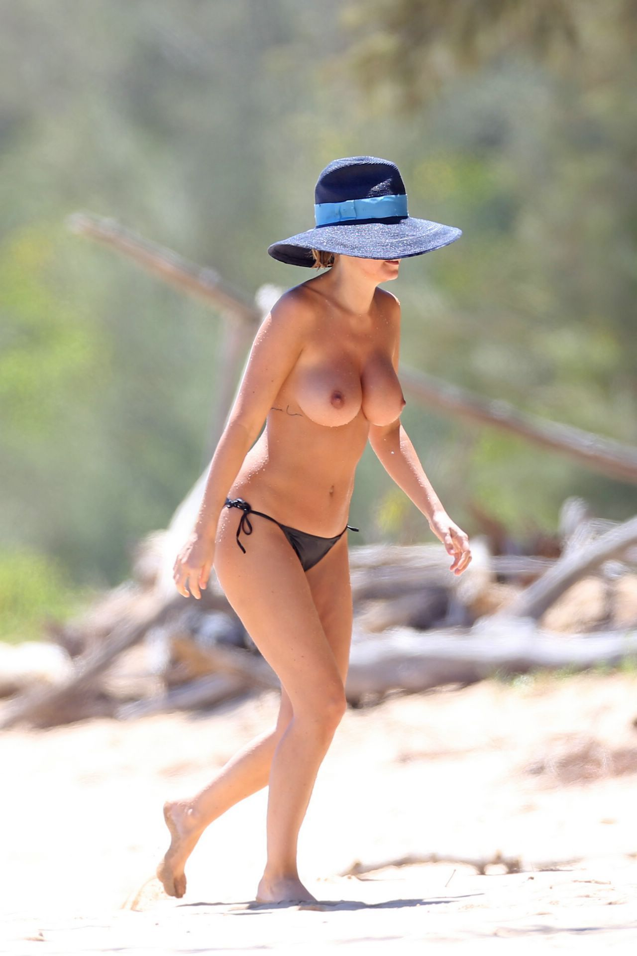 bingle beach Lara topless