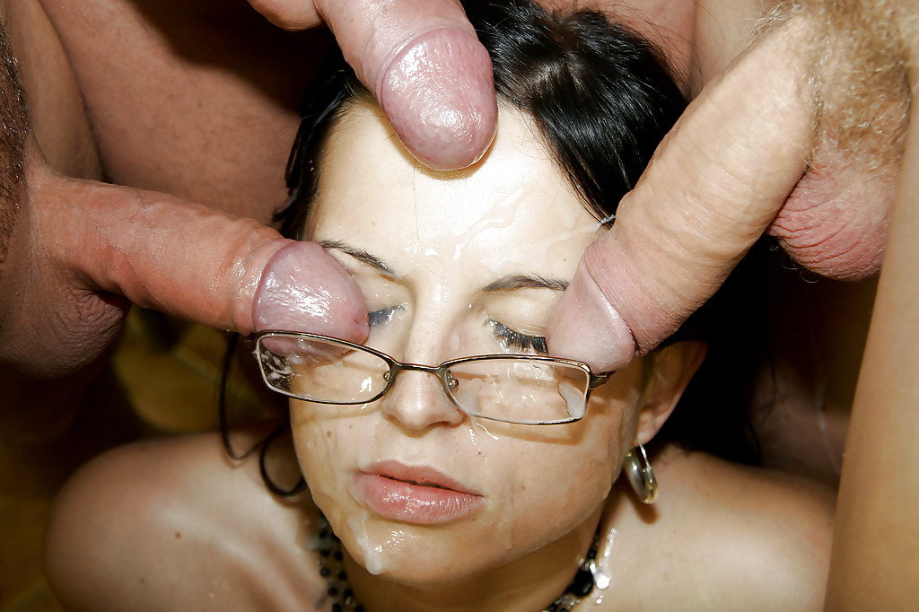 Girl with glasses cum on her face