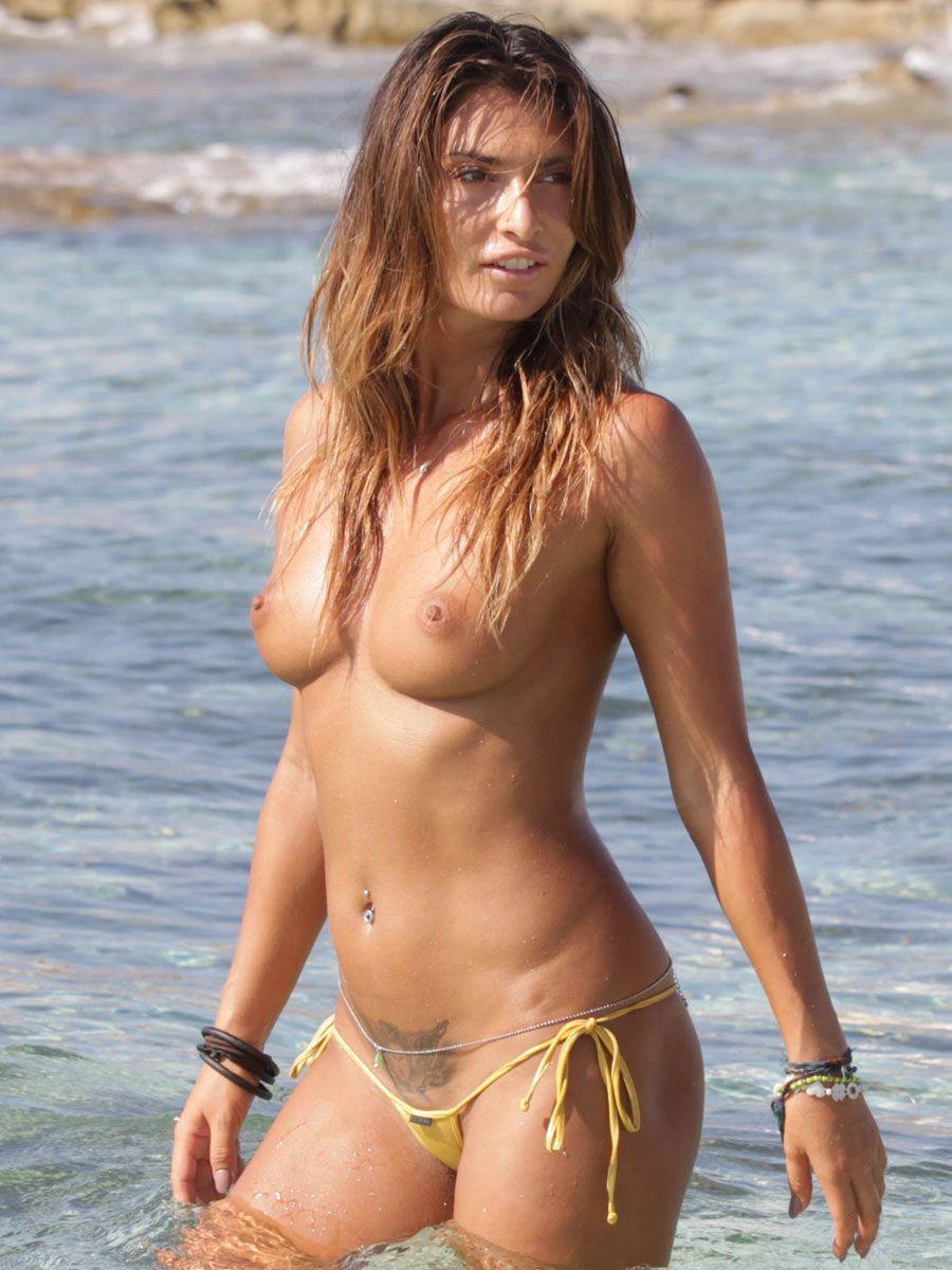 Topless micro bikini beach