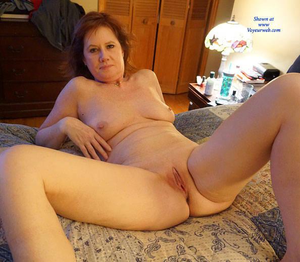 Amateur redhead milf posing nude