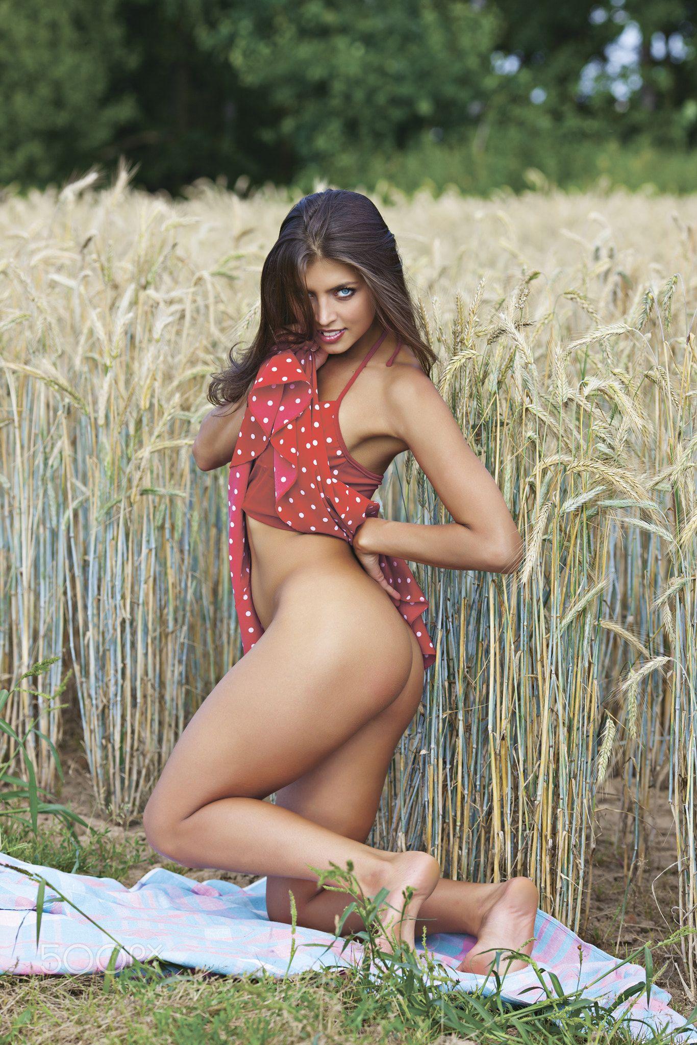Nude girl straw hut