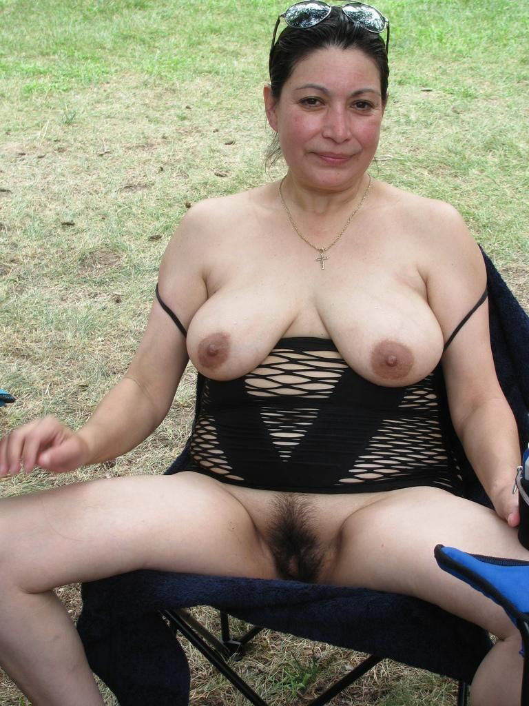 Mature naked granny outdoors