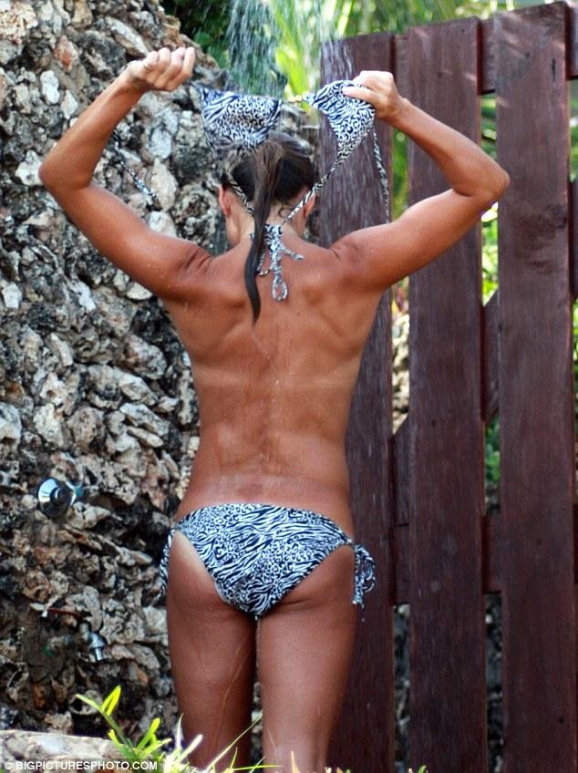 Girl removing bikini top