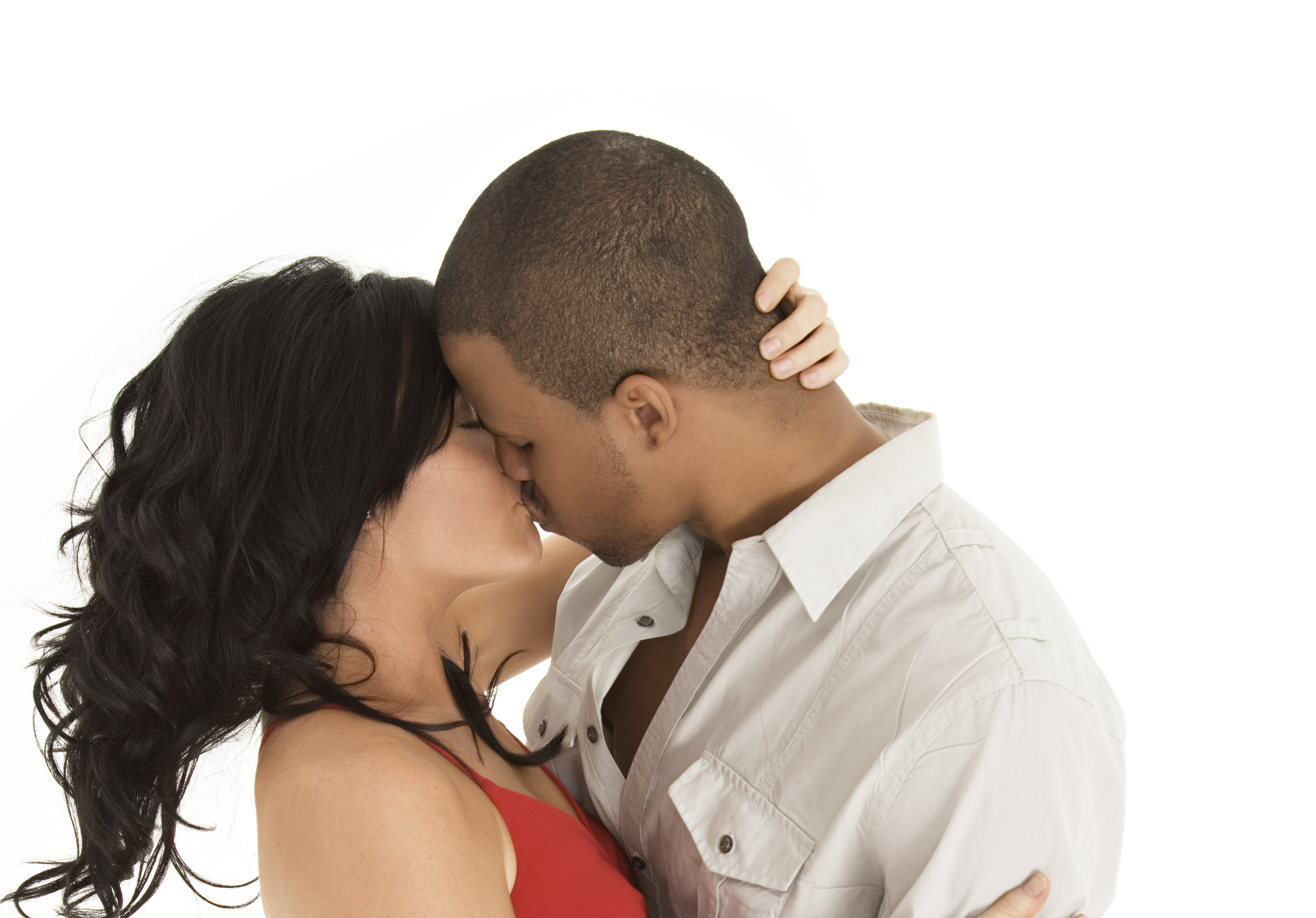 Interracial couples kissing and hugging