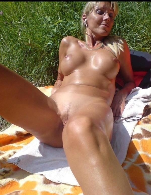 Milf sunbathing nude
