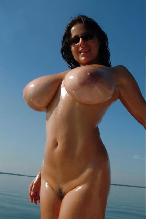 Naked women with huge tits on beach there similar