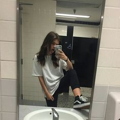 Amateur girl in bathroom stall