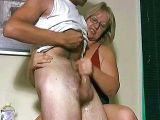 Mature and boy handjob