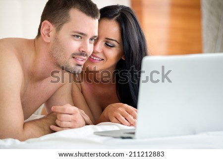 Couples watching porn at home party