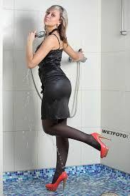 Hot brunette wets panties in shower