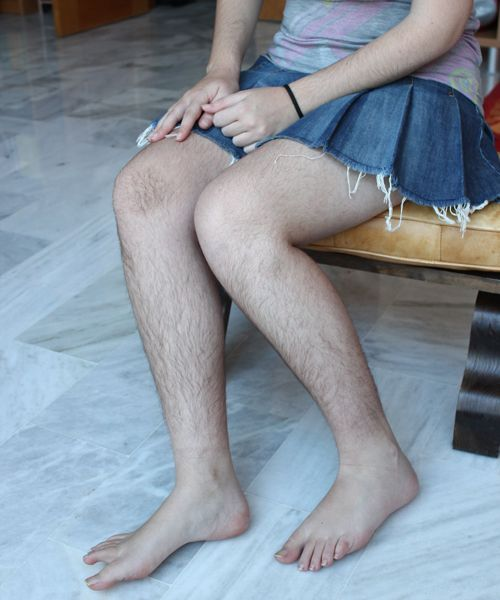 Natural hairy woman legs