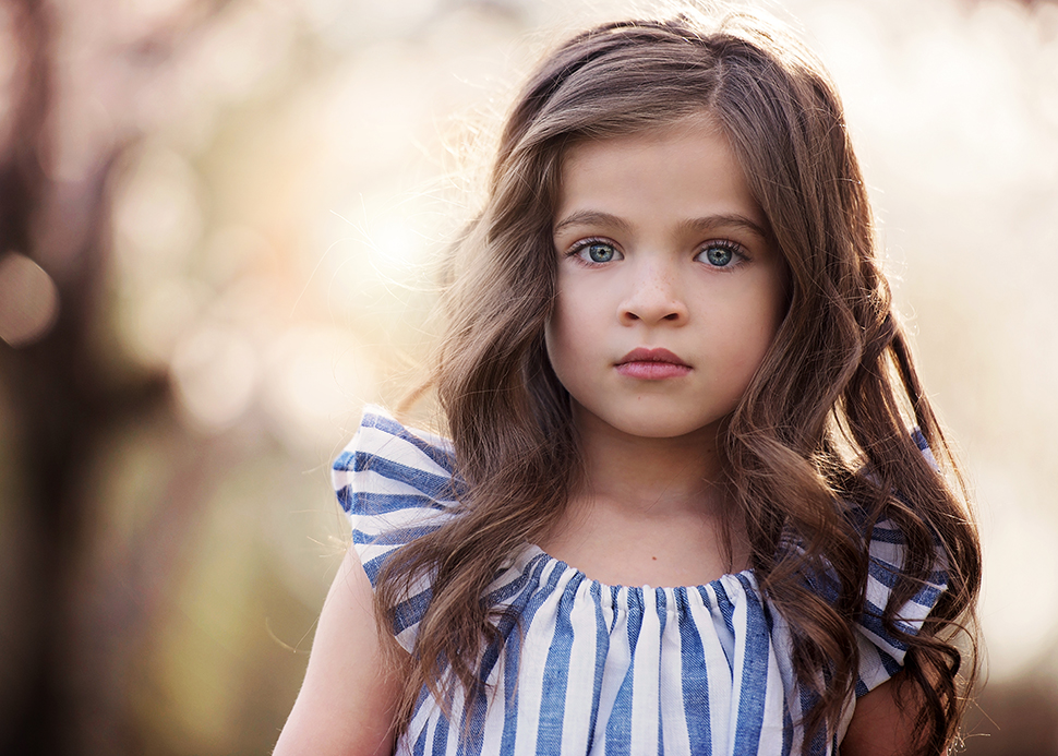 Girl with brown hair and blue eyes