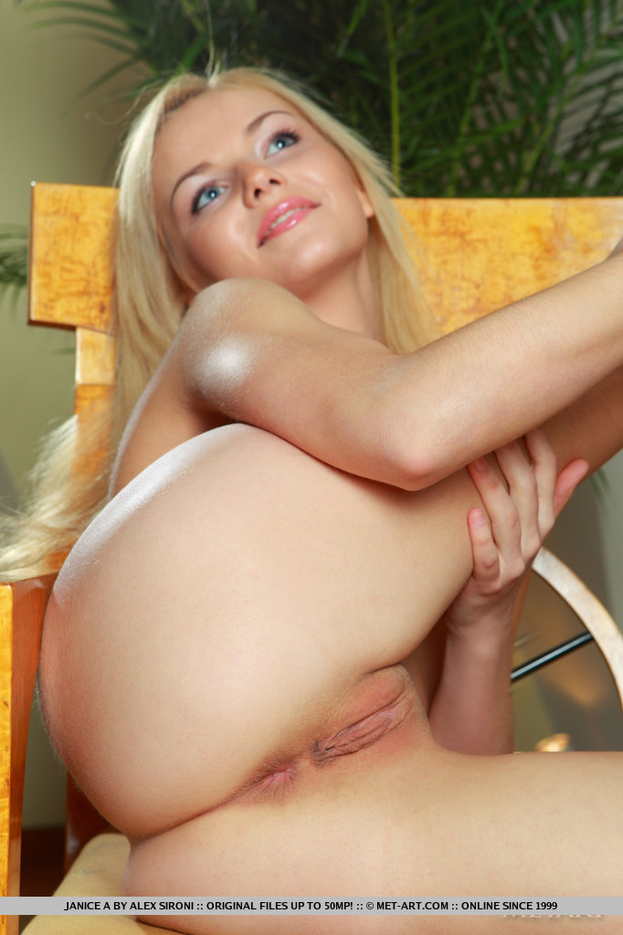 Blonde girl showing shaved pussy