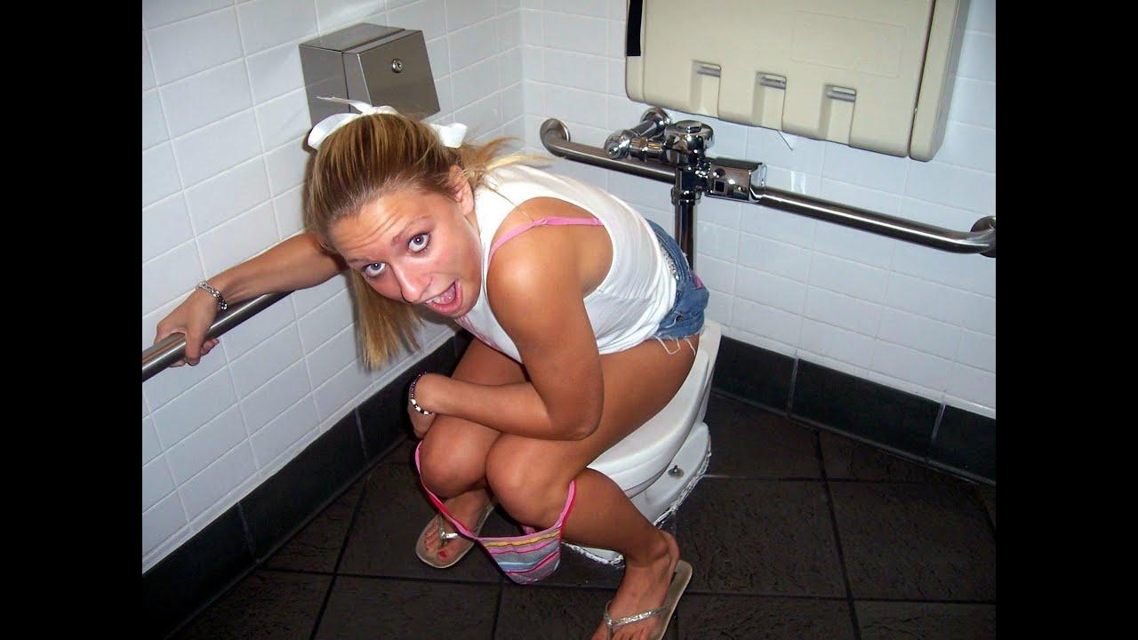 Girls caught peeing on toilet