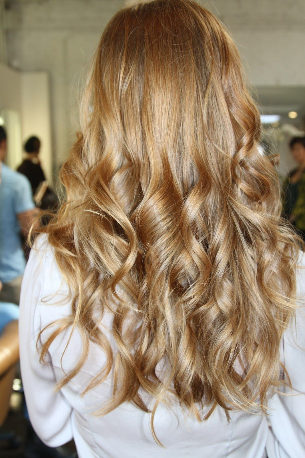 Golden honey blonde hair with highlights