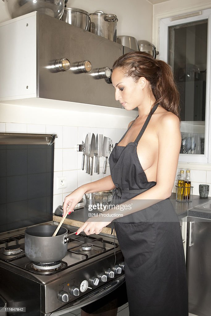 Sexy girl wearing only apron