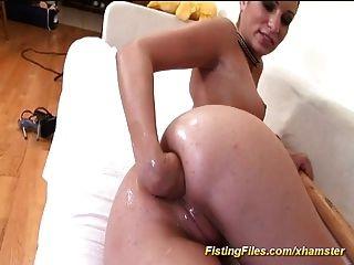 Women self fisting anal