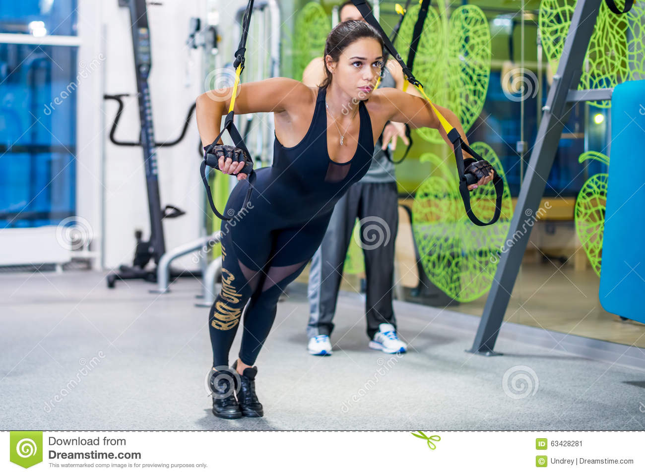 Sexy women doing trx workout