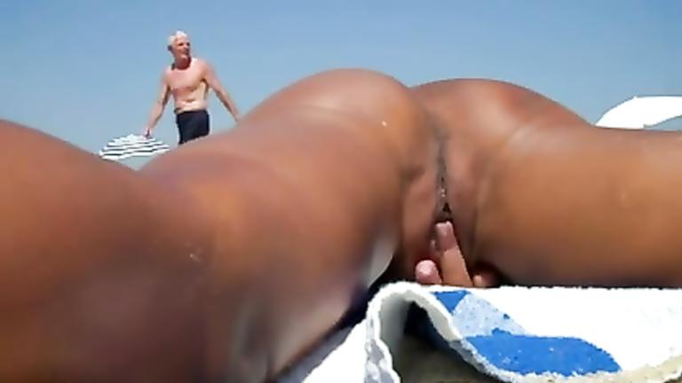 Nude sunbathing fingering pussy